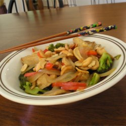 Vegetable Cashew Saute Recipe - A delicious combination of vegetables, cashews, and sauce served over whole wheat pasta.