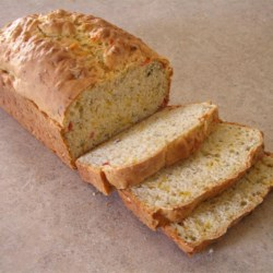 Italian Bread I Recipe - This easy quick bread gets plenty of flavor from sun-dried tomatoes, Cheddar cheese, onion, garlic and herbs.