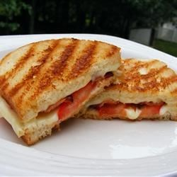 Tomato Bacon Grilled Cheese Recipe - A yummy meal that you and your kids will love! A simple golden brown grilled cheese sandwich with the twist of bacon and tomato. Hope you enjoy!