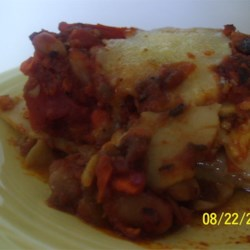 Easy Vegetarian Red Beans Lasagna Recipe - This exciting twist on lasagna features beans, Gruyere cheese, and a delicious bechamel sauce.