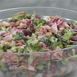 Kecia's Broccoli Salad Recipe -  Peanuts, crumbled bacon and raisins, join broccoli florets in this tasty salad that is marinated overnight in a mayonnaise dressing.