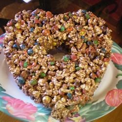 Popcorn Cake I Recipe - Fun 'cake' for kids! Adults love it too! Use different color M&Ms for various holidays (i.e., red and green for Christmas, pastels for Easter, etc.).