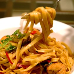 Chicken Tequila Fettuccini Recipe - Red, yellow and green bell peppers reflect the vibrancy of this creamy chicken fettucini with jalapenos, garlic and cilantro. Tequila and lime give a unique finish.