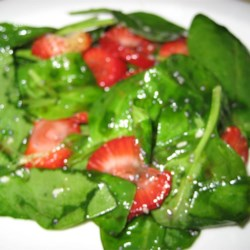 Spinach and Strawberry Salad Recipe - This salad has lots of spinach, lots of fresh, sliced strawberries, and a delicious, sweetened oil and vinegar dressing spiked with poppy and sesame seeds.