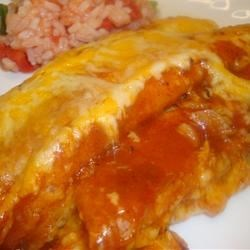 Cheese Enchiladas Recipe - These enchiladas are filled with Cheddar cheese, onion, olives and mushrooms.  Use any cheese and vegetables you prefer, and use Creole-style seasoning to taste.