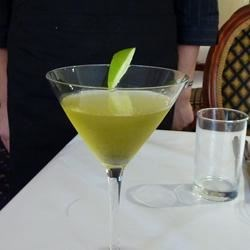 Green Apple Martini Recipe - Vodka and melon liqueur is shaken with sweet and sour mix to produce a drink with the flavor of green apple candy!