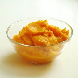 Baked Squash and Maple Syrup Recipe - Maple syrup adds just the right subtle flavor to a colorful butternut squash puree. Acorn squash also works beautifully.