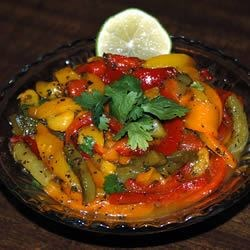 Marinated Peppers Recipe - Red, green, and yellow peppers marinated in a mixture of herbs and oils. Serve with toasted Italian or French bread slices.