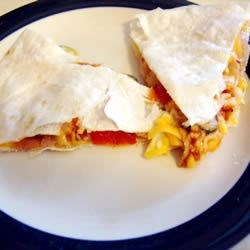 Inside-Out Pizza Recipe - Sandwich popular pizza ingredients between two flour tortillas and cook in the microwave to make a tasty 'made-in-minutes' snack guaranteed to please the small people in your household.