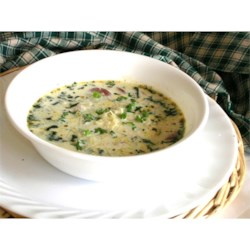 Cajun Potato Soup Recipe - This is a hearty and rich potato soup with cream, spinach, and spicy andouille sausage.
