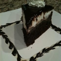 Chocolate Cheesecake III Recipe - This is a delicious recipe I made up while in college. My hubby LOVES it!! You may garnish with shaved chocolate, ganache or any other delectable chocolate. Pretty!