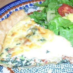 Spinach Pie I Recipe - To make this easy quiche, crumbled bacon and chopped spinach are covered with a savory custard mixture and topped with shredded cheese. The pie is baked in a hot oven for about 30 minutes.