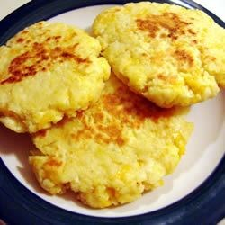 Potato Pancakes II Recipe - Crispy, golden and cheesy! Good use of leftover mashed potatoes. This recipe is very versatile: you can add minced garlic, chives, or 1/4 cup of any shredded raw vegetable, or substitute the cheese with a tablespoon of sugar and serve with maple syrup.