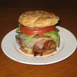 Aloha Chicken Burgers Recipe - Break out the tiki torches, it's time to fire up the grill and make these grilled chicken sandwiches with bacon, pineapple, and teriyaki sauce.
