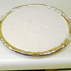 Pineapple Pie II Recipe - This pie is creamy, light and delicious. Condensed milk, whipped topping, crushed pineapple and lemon juice are all stirred and folded together to make a divine filling that everyone will think you spent hours making in the kitchen. Serve chilled with whipped cream and fresh strawberries.
