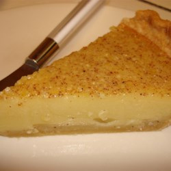 Egg Custard Pie III Recipe - This very old recipe has a small amount of milk and a bit of flour stirred into the custard, so it bakes up more dense than a traditional custard. And the nutmeg adds a wonderful flavor to this heavier baked pie. Serve warm or cold with whipped cream.