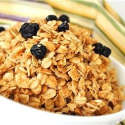 Coconut Granola Recipe - A quick, easy, and very delicious recipe that can be eaten for cold cereal, topping on yogurt or even for a snack. Because it does a better job than honey, I use part maltose syrup (purchased at Asian markets) to help bind the ingredients together instead of using all honey. Virgin coconut oil has many healthy properties and enhances the taste of the granola, but if that cannot be found you can substitute it with any other oil. Enjoy!