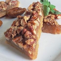 Maple Pecan Shortbread Squares Recipe - Real maple syrup flavors the sticky pecan topping of these delicious shortbread squares.