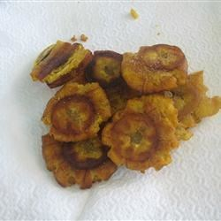 Tostones Recipe - Fried plantains are cut into chips for another fantastic little appetizer from Puerto Rico. Tostones may be served with ketchup (kid's favorite) or with garlic in olive oil.