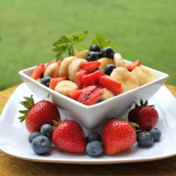 Red, White, and Blueberry Fruit Salad Recipe - The simplest red, white, and blue fruit salad has strawberries, blueberries, and bananas for the colors of the flag.