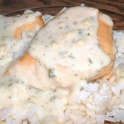 Broiled Chicken with Roasted Garlic Sauce Recipe - Roasting the garlic mellows the flavor, so do use the whole head in this garlic-Parmesan sauce.  Serve on a bed of pasta or rice for a special presentation.