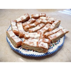 Swedish Kringles Recipe - This holiday treat is a simple pastry baked with a buttery almond flavored topping.