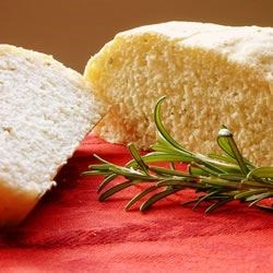 Delicious Rosemary Bread Recipe - This super easy recipe brings incredible taste and fragrance to any dinner table. It also goes wonderfully with a garlic flavored olive oil.