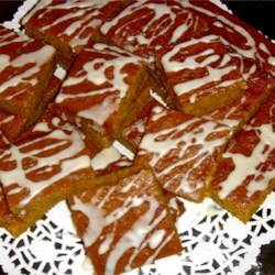 Pumpkin Bars III Recipe - Moist pumpkin bars with raisins and a maple glaze. A fall favorite.