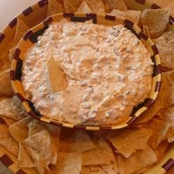 Cheesy Sour Cream and Salsa Dip Recipe - This creamy chip dip recipe mixes sour cream with tomatoes and green chilies, black olives and Cheddar cheese. Always a hit at parties. Great texture and taste!
