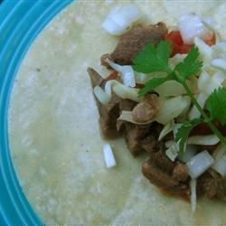 Tongue Tacos Recipe - Warm corn tortillas filled with hot beef tongue and cool tomatoes, onion and cilantro sprinkled with lemon.