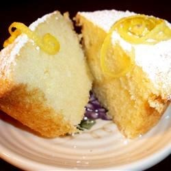 Greek Lemon Cake Recipe - This cake recipe features lemon zest, lemon juice, and yogurt to achieve a very lovely and light Greek-style cake.