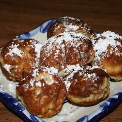 Laura's Famous Aebleskiver Recipe - This traditional Danish breakfast treat made with a special aebleskiver pan is a cross between a pancake and a popover. Sprinkle with confectioners sugar or drizzle with maple syrup or jam.