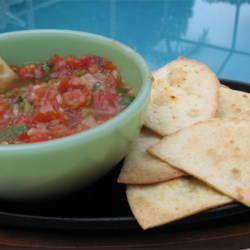 The Best Fresh Tomato Salsa Recipe and Video - Keep it fresh by mixing fresh chopped tomatoes, onion, bell pepper, and cilantro with lime juice for a quick and simple salsa.