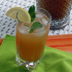 Mint Tea Punch Recipe - Tea, mint, sugar, orange and lemon juices make this a quick and easy, refreshingly delicious drink on a hot summer's day, given to me by a true Southern lady. Goes great with Cajun or spicy foods too. Every time I serve this someone asks me for the recipe!