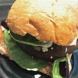 Portobello Burgers with Goat Cheese Recipe - Delicious broiled portobello mushrooms layered with goat cheese, roasted beets, and a pseudo aioli sauce.
