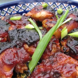 Caramelized Baked Chicken Recipe and Video - Soy and ketchup, laced with honey and garlic, make for a potent sauce.  This chicken is ideal for appetizers or a main course.