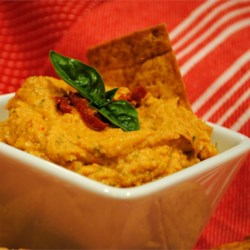 Quick Sun-Dried Tomato and Basil Hummus Recipe -  This hummus featuring basil and sun-dried tomato is easy to whip up on a moment's notice.