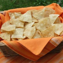 Corn Tortilla Chips Recipe - Here's a simple recipe for making corn tortilla chips spiced only with salt. The chips may alternately be prepared by baking the tortilla wedges in a 350 degrees F (175 degrees C) oven for 5 minutes, or until crisp.