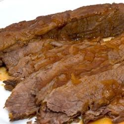 Jewish Style Sweet and Sour Brisket Recipe - Tender beef brisket is smothered in a tangy and sweet gravy.