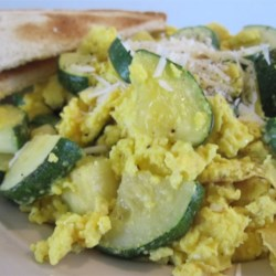 Zucchini and Eggs Recipe - Adding zucchini, Parmesan cheese, and garlic powder to eggs makes for a delicious meal at any time of day.