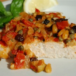 Swordfish a la Siciliana Recipe - Sweet raisins, sour olives and piquant capers conspire to make this a memorable main dish.