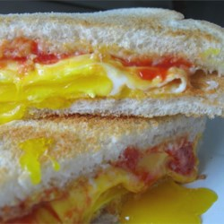 Fried Egg Sandwich Recipe - You'll never buy a fast food breakfast again once you've learned how to make these quick and easy egg and cheese sandwiches in your own kitchen.