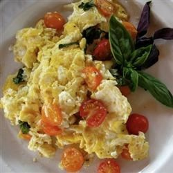 Scrambled Eggs and Tomatoes Recipe - A fast meal of eggs scrambled with tomatoes, and then seasoned with salt, sugar, and soy sauce. A great summertime recipe for using fresh tomatoes.