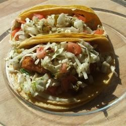 Taco Slaw Recipe - A crisp and spicy Mexican-inspired cabbage slaw is the perfect topping for grilled fish or chicken tacos.