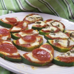 Grilled Zucchini Pizza Recipe - Large zucchini rounds topped with pizza sauce and cheese, then cooked on the grill.