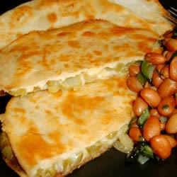 Tortillas with Cactus and Cheese Recipe - Tortillas are stuffed with tender nopales (cactus) seasoned with adobo seasoning, Cheddar cheese, and cilantro,