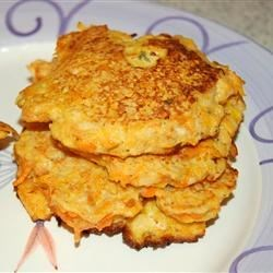 Carrot Patties Recipe -  Just like potato pancakes only shredded carrots star in this one. Eggs, flour, breadcrumbs and garlic surround and bind the carrot together. They cook up crusty and golden and are so good with homemade applesauce.