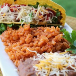 Mexican Rice II Recipe - Rice is cooked with cumin and onion, then simmered with tomato sauce and chicken broth for this restaraunt-inspired Mexican rice recipe.