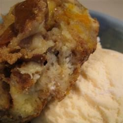 Grandmother's Apple Bread Pudding Recipe - Bread, raisins and apples are baked with eggs and cinnamon, then topped with a sweet, warm vanilla sauce. A great way to use up leftover bread!