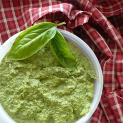 Pesto with Arugula Recipe - This pesto is unique due to the arugula, which gives it a peppery bite. I also like the lack of cheese, but add it if you must. Use as a spread or on pasta. My favorite is on baguette slices or on whole wheat crackers. It's addictive!